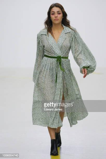 A model walks the runway during the Tako Mekvabidze Spring/Summer 2019 Collection fashion show at MercedesBenz Fashion Week Tbilisi on November 2...
