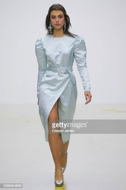 A model walks the runway during the Tako Mekvabidze Spring/Summer 2019 Collection fashion show at MercedesBenz Fashion Week Tbilisi on November 2...
