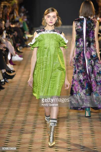 A model walks the runway during the Talbot Runhof show as part of Paris Fashion Week Womenswear Fall/Winter 2018/2019 on March 3 2018 in Paris France
