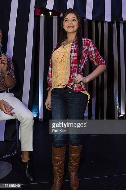 A model walks the runway during the Target Fall Fashion Runway Show at the Festival People en Español Presented by Target at the Henry B Gonzalez...