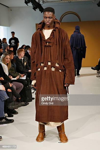 Model walks the runway during the Telfar presentaion during Mercedes-Benz Fashion Week Fall 2014 at The New Museum on February 10, 2014 in New York...
