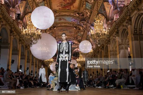 A model walks the runway during the Thom Browne fashion show as part of the Paris Fashion Week Womenswear Spring/Summer 2018 on October 3 2017 in...
