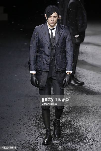 A model walks the runway during the Thom Browne Menswear Fall/Winter 20152016 show as part of Paris Fashion Week on January 25 2015 in Paris France