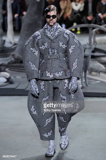 A model walks the runway during the Thom Browne Menswear Fall/Winter 20142015 show as part of Paris Fashion Week on January 19 2014 in Paris France