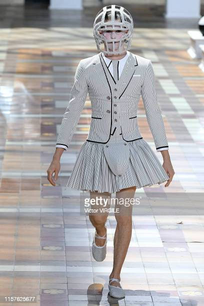 A model walks the runway during the Thom Browne Menswear Spring Summer 2020 fashion show as part of Paris Fashion Week on June 22 2019 in Paris France