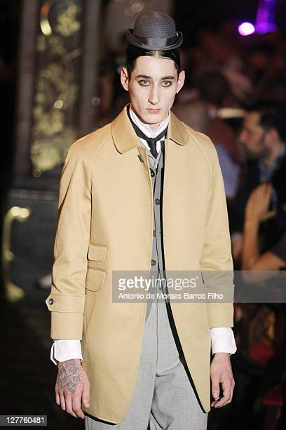 Model walks the runway during the Thom Browne Menswear Spring/Summer 2012 show as part of Paris Fashion Week at on June 26, 2011 in Paris, France.