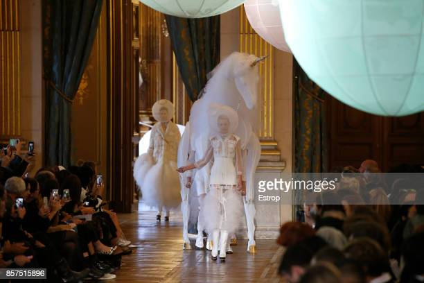 A model walks the runway during the Thom Browne Paris show as part of the Paris Fashion Week Womenswear Spring/Summer 2018 on October 3 2017 in Paris...