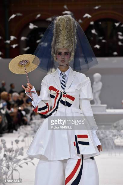 Model walks the runway during the Thom Browne Ready to Wear Spring/Summer 2020 fashion show as part of Paris Fashion Week on September 29, 2019 in...