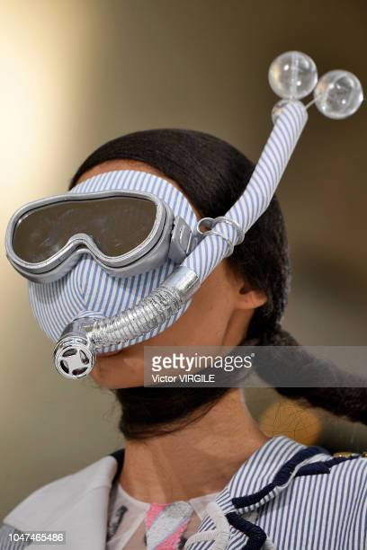 A model walks the runway during the Thom Browne Ready to Wear fashion show as part of the Paris Fashion Week Womenswear Spring/Summer 2019 on...