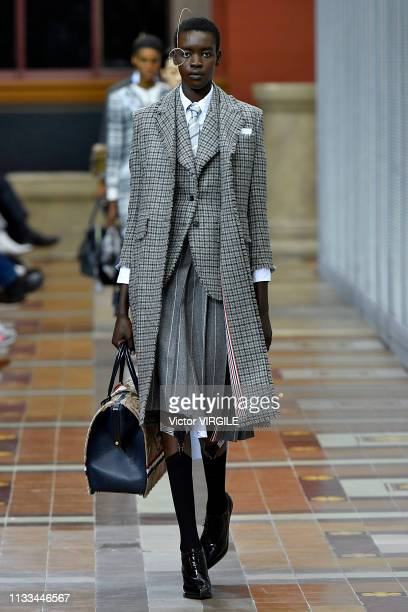 A model walks the runway during the Thom Browne Ready to Wear fashion show as part of the Paris Fashion Week Womenswear Fall/Winter 2019/2020 on...
