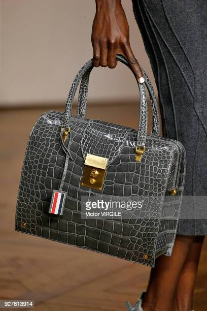 A model walks the runway during the Thom Browne Ready to Wear Fashion show as part of the Paris Fashion Week Womenswear Fall/Winter 2018/2019 on...