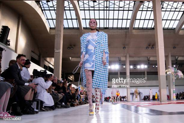 A model walks the runway during the Thom Browne show as part of the Paris Fashion Week Womenswear Spring/Summer 2019 on September 30 2018 in Paris...