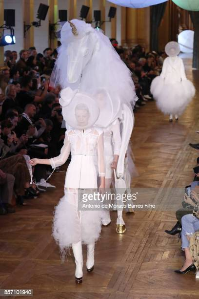 A model walks the runway during the Thom Browne show as part of the Paris Fashion Week Womenswear Spring/Summer 2018 on October 3 2017 in Paris France