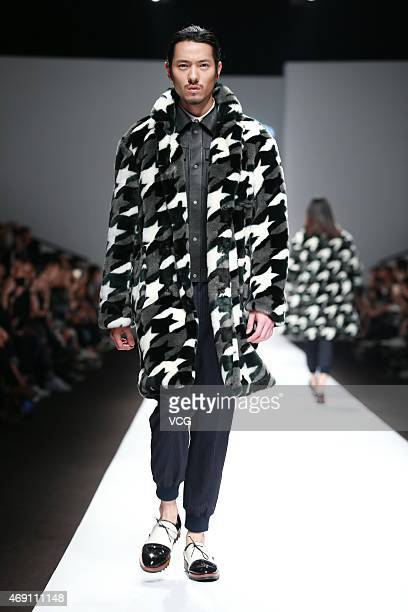 Model walks the runway during the threeSociety show as part of Shanghai Fashion Week Autumn/Winter Collection on April 9, 2015 in Shanghai, China.