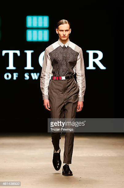 A model walks the runway during the Tiger Of Sweden show at the London Collections Men AW15 at on January 12 2015 in London England