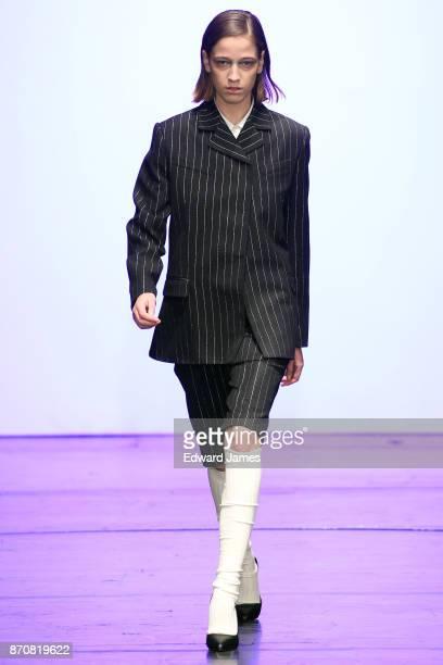 A model walks the runway during the Tiko Paska fashion show at MercedesBenz Fashion Week Tbilisi on November 5 2017 in Tbilisi Georgia