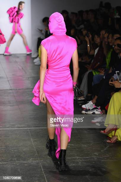 A model walks the runway during the TMall China Day Angel Chen fashion show during September 2018 New York Fashion Week at Industria Studios on...