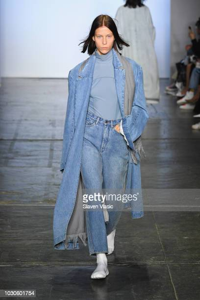 A model walks the runway during the TMall China Day JBNY fashion show during the September 2018 New York Fashion Week at Industria Studios on...