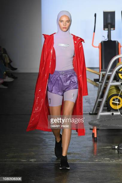 A model walks the runway during the TMall China Day Particle Fever fashion show during September 2018 New York Fashion Week at Industria Studios on...