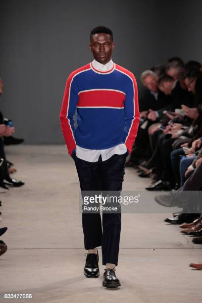 A model walks the runway during the Todd Snyder NYFW Men's show at Skylight Clarkson North on February 1 2017 in New York City