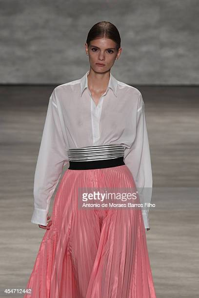 Model walks the runway during the TOME show during Mercedes-Benz Fashion Week Spring 2015 at The Pavilion at Lincoln Center on September 4, 2014 in...