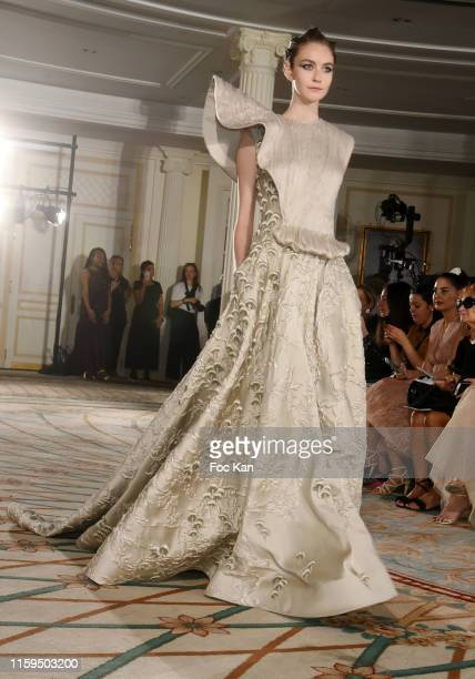 Model walks the runway during the Tony Ward Haute Couture Fall/Winter 2019 2020 show as part of Paris Fashion Week on July 01, 2019 in Paris, France.