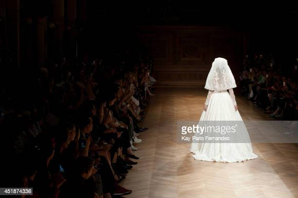 Model walks the runway during the Tony Ward show as part of Paris Fashion Week Haute Couture Fall/Winter 20142015 at on July 8 2014 in Paris France