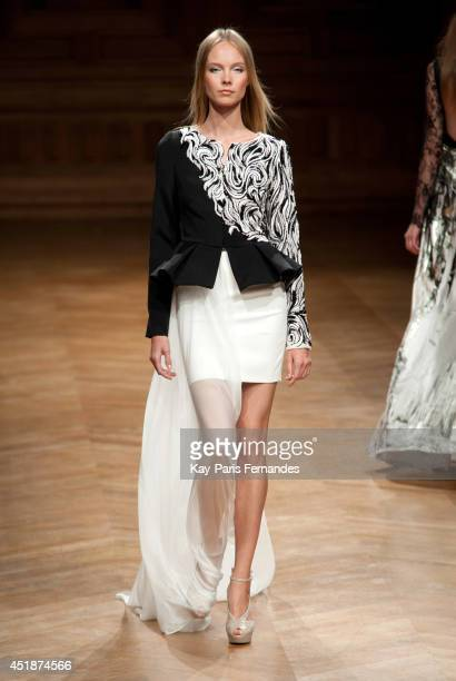 Model walks the runway during the Tony Ward show as part of Paris Fashion Week Haute Couture Fall/Winter 2014-2015 at on July 8, 2014 in Paris,...