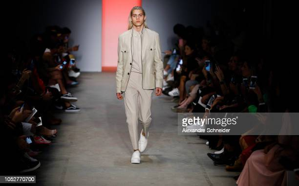 A model walks the runway during the Torinno fashion show during Sao Paulo Fashion Week N46 Winter 2019 at Arca on October 22 2018 in Sao Paulo Brazil