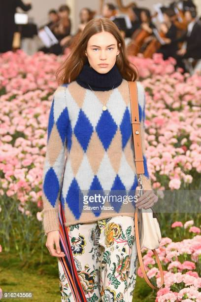 A model walks the runway during the Tory Burch Fall Winter 2018 Fashion Show during New York Fashion Week at Bridge Market on February 9 2018 in New...