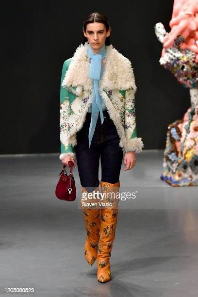 Model walks the runway during the Tory Burch Fall Winter 2020 Fashion Show at Sotheby's on February 09, 2020 in New York City.