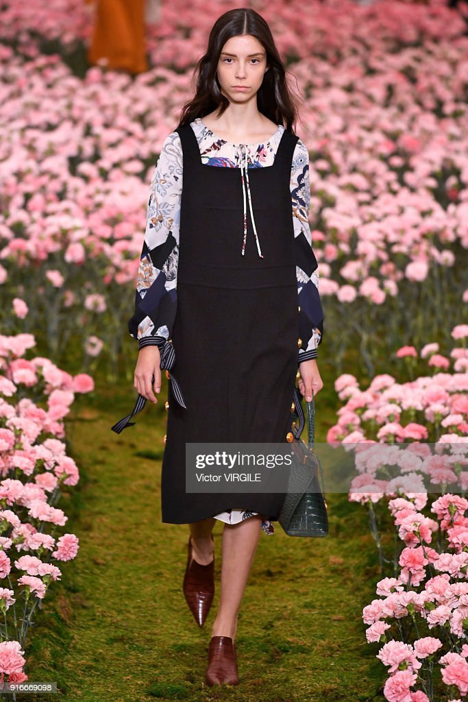 A model walks the runway during the Tory Burch Ready to Wear Fall/Winter 2018-2019 fashion show during New York Fashion Week at Bridge Market on February 9, 2018 in New York City.