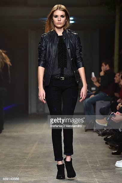 A model walks the runway during the Trussardi Jeans FW 15/16 fashion show at Laboratori Ansaldo Scala on November 17 2014 in Milan Italy