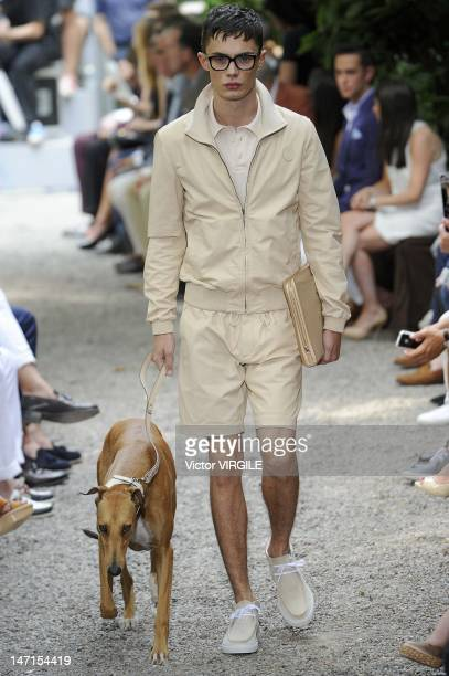 A model walks the runway during the Trussardi ready to Wear Spring/Summer 2013 show as part of the Milan Men Fashion Week on June 24 2012 in Milan...