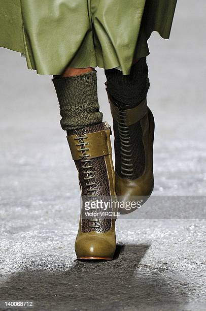 A model walks the runway during the Trussardi Ready to Wear Fall/Winter 20122013 show as part of the Milan Fashion Week on February 26 2012 in Milan...