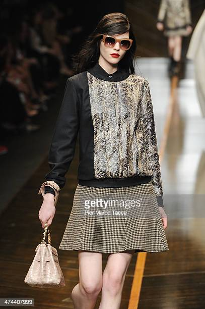 A model walks the runway during the Trussardi show as part of Milan Fashion Week Womenswear Autumn/Winter 2014 on February 23 2014 in Milan Italy