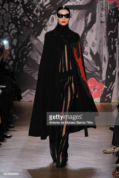 Model walks the runway during the Tsumori Chisato Fall/Winter 2013 Ready-to-Wear show as part of Paris Fashion Week on March 2, 2013 in Paris, France.