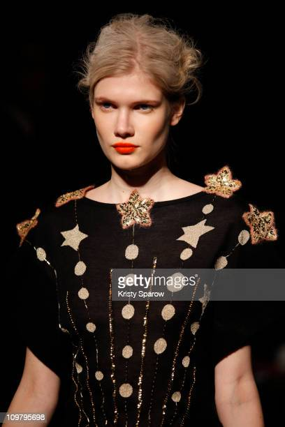 Model walks the runway during the Tsumori Chisato Ready to Wear Autumn/Winter 2011/2012 show during Paris Fashion Week at Hotel Westin on March 5,...