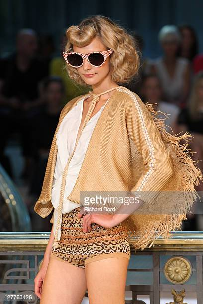 Model walks the runway during the Tsumori Chisato Ready to Wear Spring / Summer 2012 show during Paris Fashion Week at Centorial on October 1, 2011...