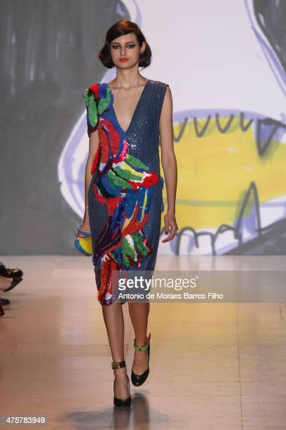 Model walks the runway during the Tsumori Chisato show as part of the Paris Fashion Week Womenswear Fall/Winter 2014-2015 on March 1, 2014 in Paris,...