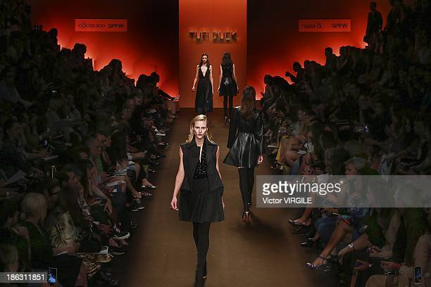 A model walks the runway during the Tufi Duek show at the Sao Paulo Fashion Week Winter 2014 on October 28 2013 in Sao Paulo Brazil