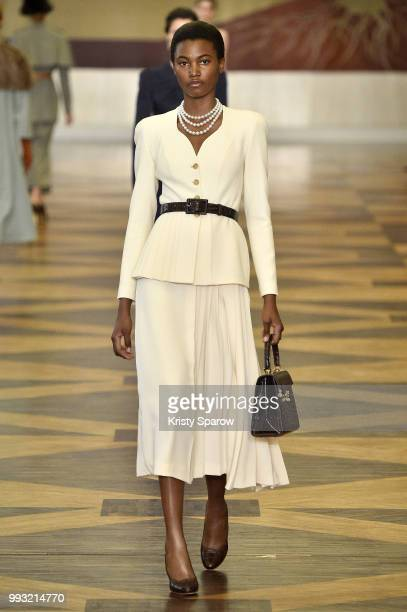 A model walks the runway during the Ulyana Sergeenko Haute Couture Fall Winter 2018/2019 show as part of Paris Fashion Week on July 3 2018 in Paris...