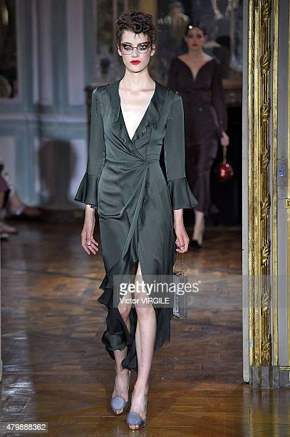 Model walks the runway during the Ulyana Sergeenko show as part of Paris Fashion Week Haute Couture Fall/Winter 2015/2016 on July 5, 2015 in Paris,...