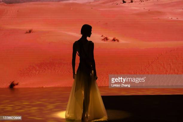 "Model walks the runway during the "" Unity"" collection show by Chinese designer Grace Chen on day 6 of Beijing Fashion Week at Wangfujing street on..."