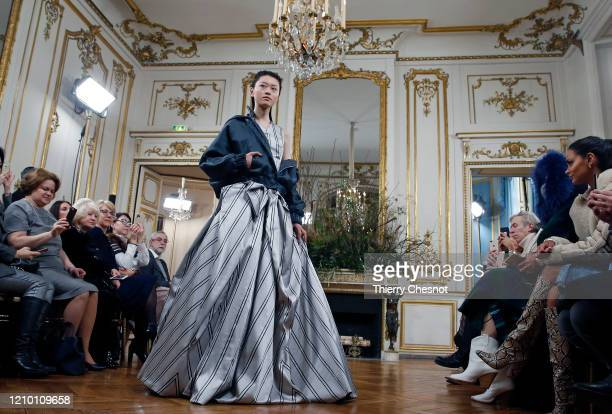 Model walks the runway during the Valentin Yudashkin as part of the Paris Fashion Week Womenswear Fall/Winter 2020/2021 on March 03, 2020 in Paris,...