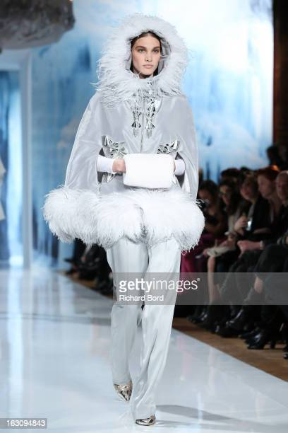 Model walks the runway during the Valentin Yudashkin Fall/Winter 2013 Ready-to-Wear show as part of Paris Fashion Week at Hotel Westin on March 4,...