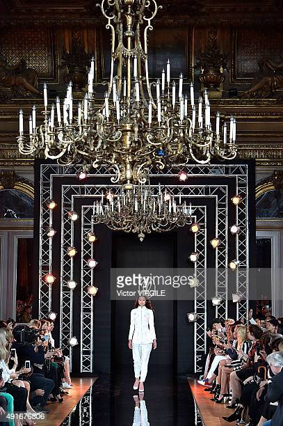 Model walks the runway during the Valentin Yudashkin Ready to Wear show as part of the Paris Fashion Week Womenswear Spring/Summer 2016 on October 6,...