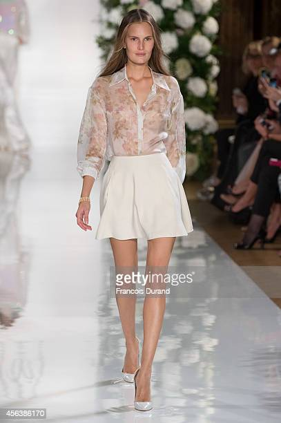 A model walks the runway during the Valentin Yudashkin show as part of the Paris Fashion Week Womenswear Spring/Summer 2015 on September 30 2014 in...