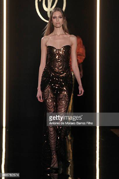 Model walks the runway during the Valentin Yudashkin show as part of the Paris Fashion Week Womenswear Fall/Winter 2015/2016 on March 10, 2015 in...