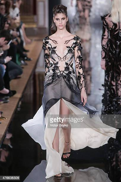 Model walks the runway during the Valentin Yudashkin show as part of the Paris Fashion Week Womenswear Fall/Winter 2014-2015 on March 4, 2014 in...